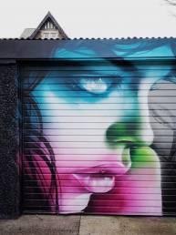 cardiff-graffiti-mural-shutter-portrait-colours-woman-rmer